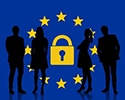 Silhouettes of people gathered around the stars of the European Union enclosing a padlock icon